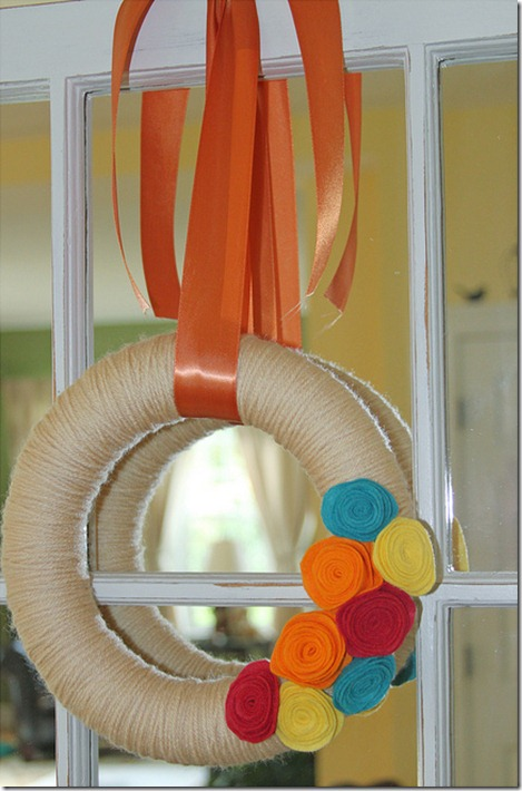 yarn wreath with rosettes