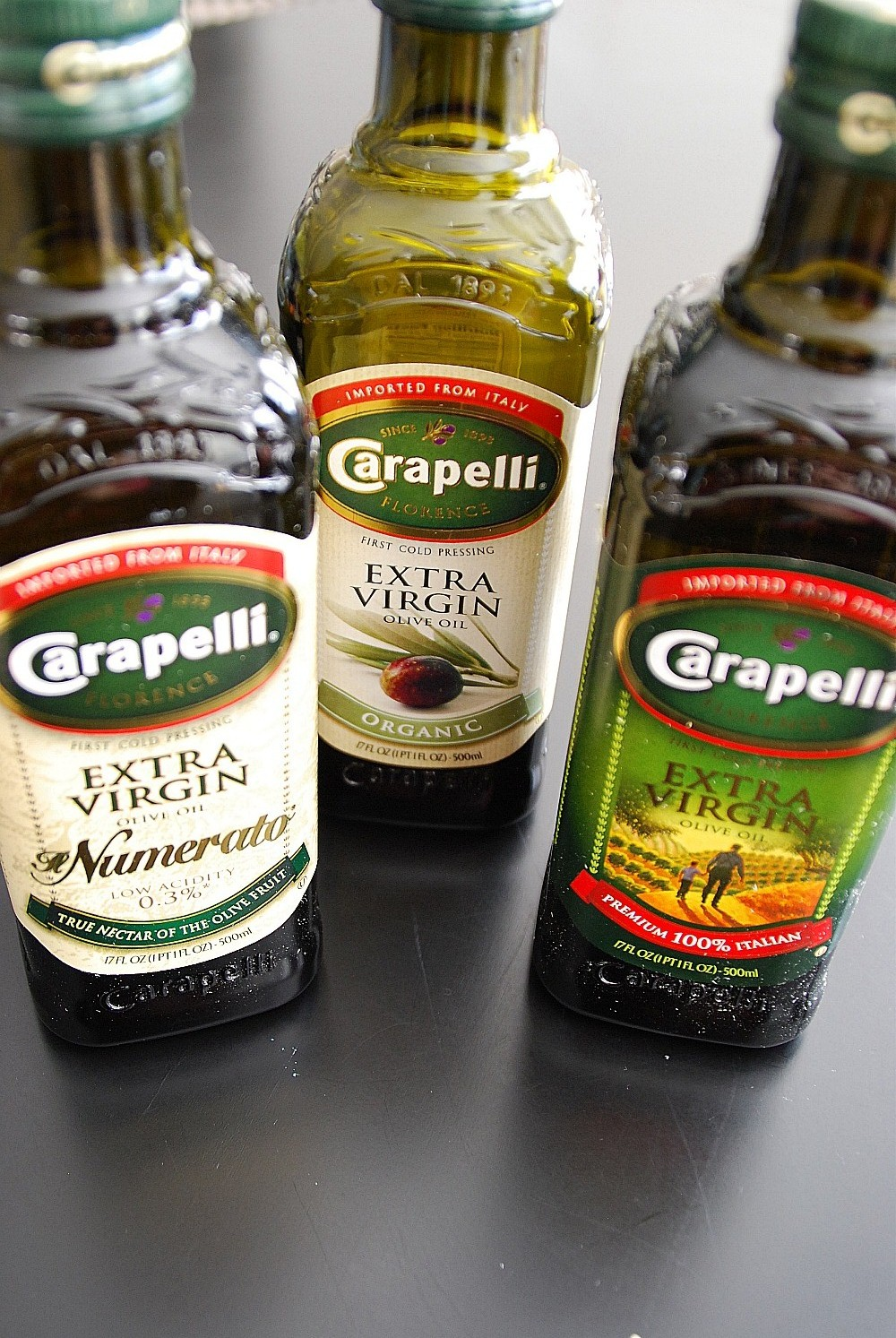 Three Bottles of Carapelli Olive Oil