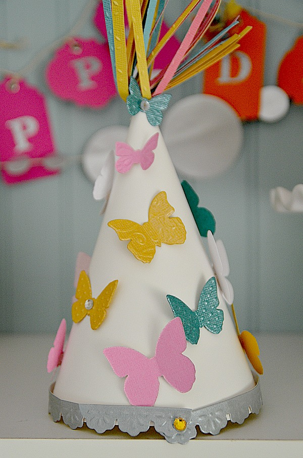 Make diy paper party hats and party decorations for Making butterfly decorations