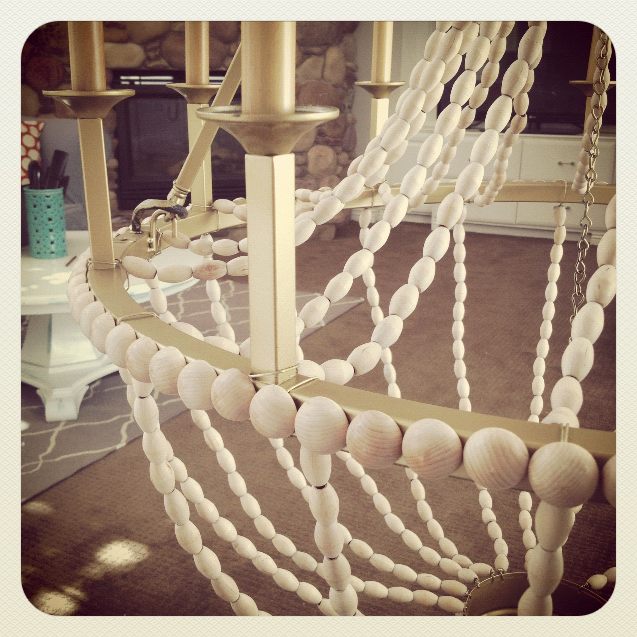 Upcycle a plain chandelier into a beaded showpiece i made a new wood bead chandelier aloadofball Image collections