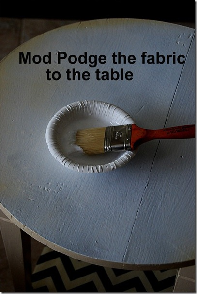 mod podge the fabric to the table
