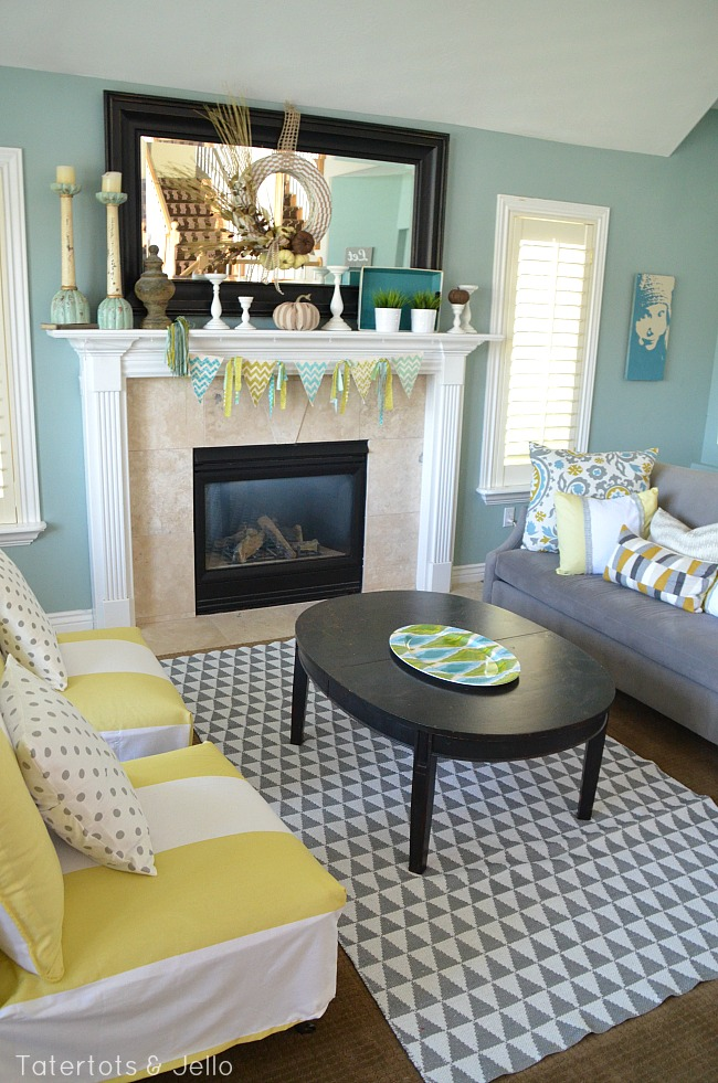 grey and yellow living room at tatertots and jello