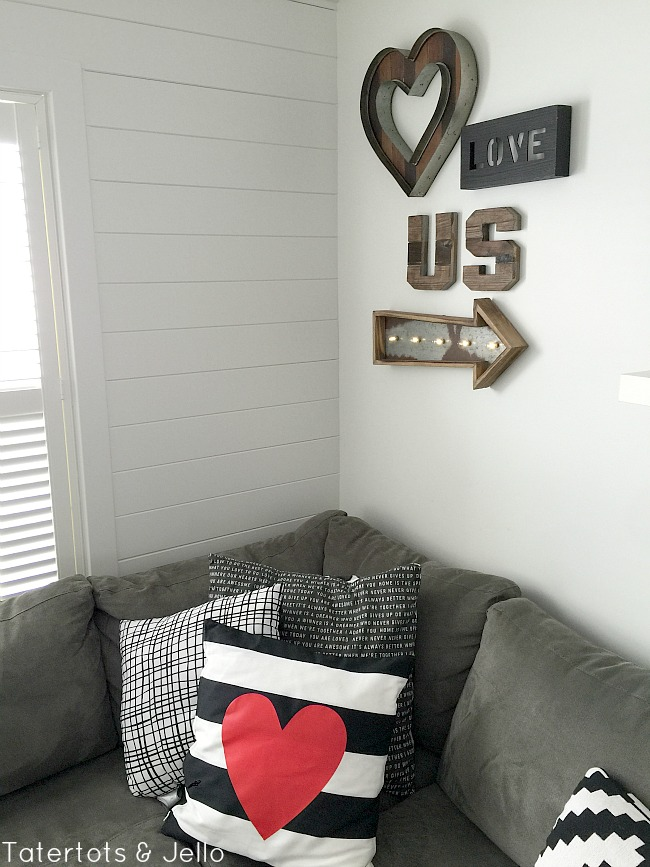 create a gallery wall with wood and metal