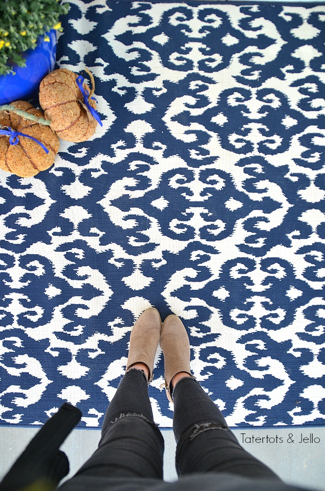 colorful rug for a fall porch