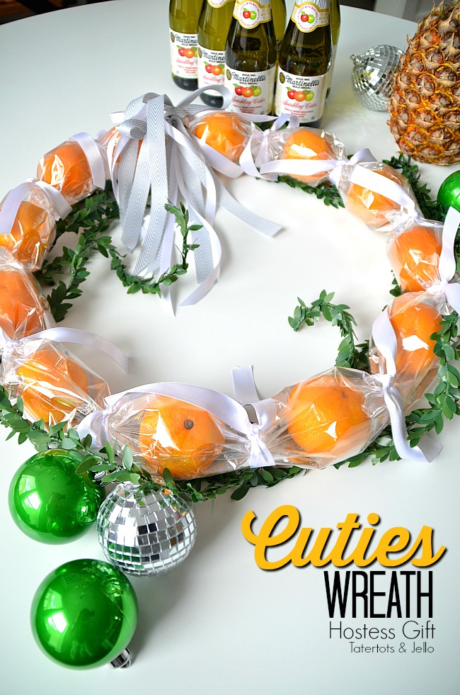 Holiday Gift Idea Edible Wreath. Make a fresh and beautiful wreath for your neighbors or as a hostess gift idea. Fresh cutie oranges are beautiful and great to eat.