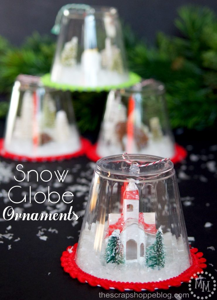 DIY Snow Globe Ornament Craft. Make these little snow globe ornaments to hang on your tree or as a little village to display in your home!