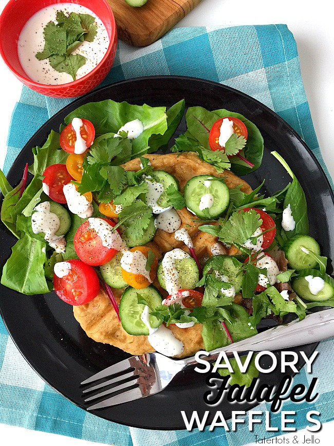 Savory Falafel Waffles are a savory dinner idea. Warm and savory waffles that taste like falafels are surrounded by a cool salad and tangy yogurt dressing.