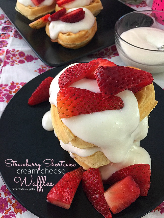 Strawberry Shortcake Cream Cheese Waffles. Make these for brunch or as a dessert. Your family will love the fluffy waffles covered with a light sweet cream cheese topping and strawberries!