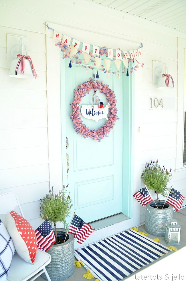 Patriotic Flag Wreath Tutorial. Make a red white and blue flag wreath with inexpensive flag garlands. Easy patriotic wreath tutorial to make your door SHINE for The Fourth!