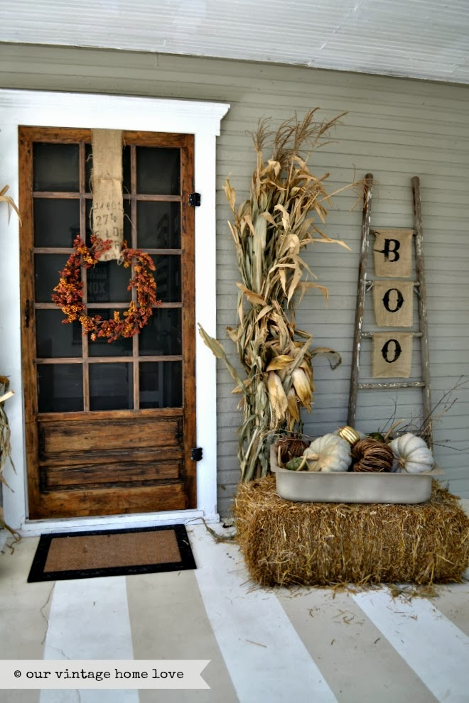 Rustic fall porch at Our Vintage Home Love.