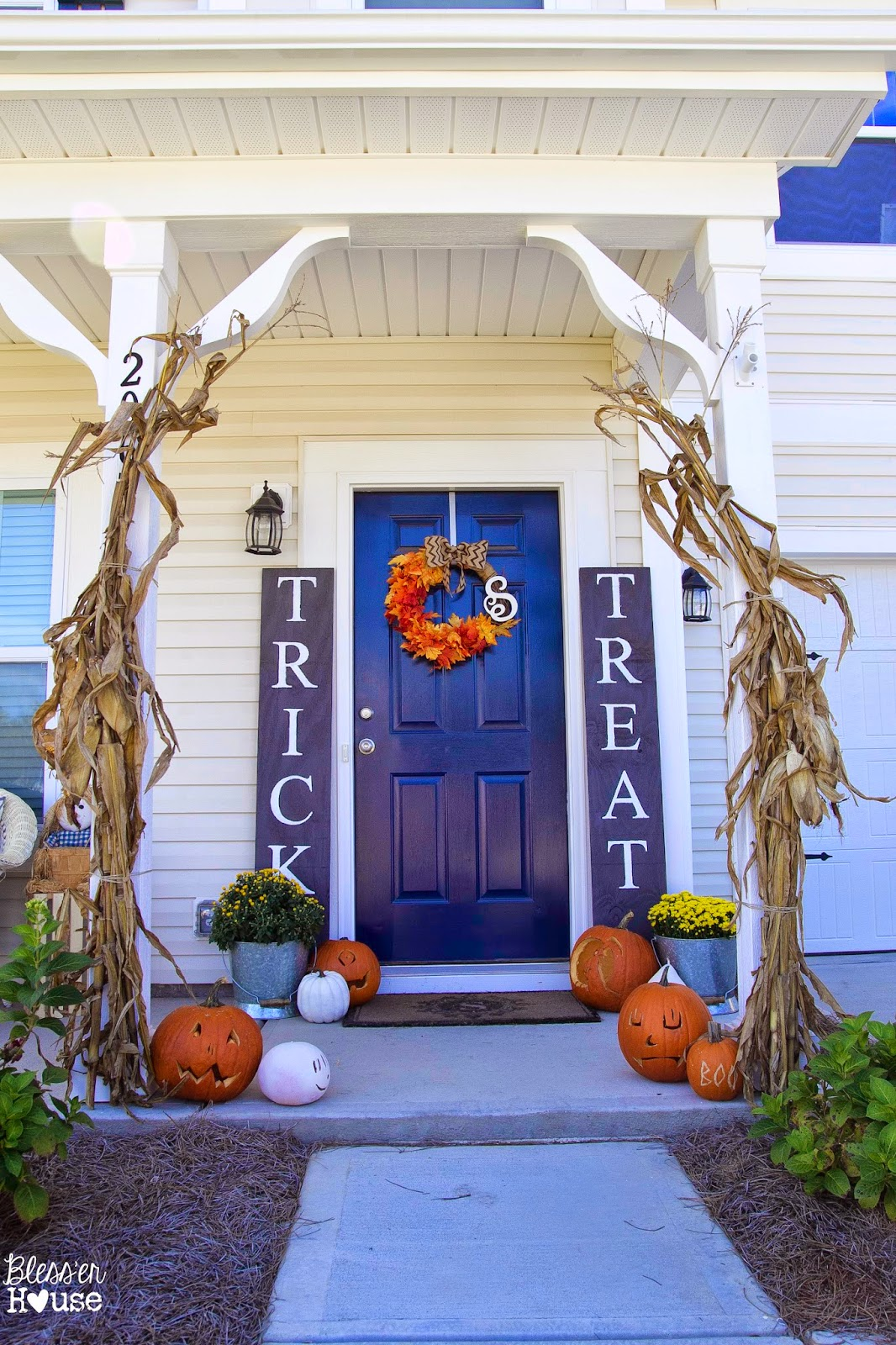 Fall porch with giant trick or treat signs at Blesser House