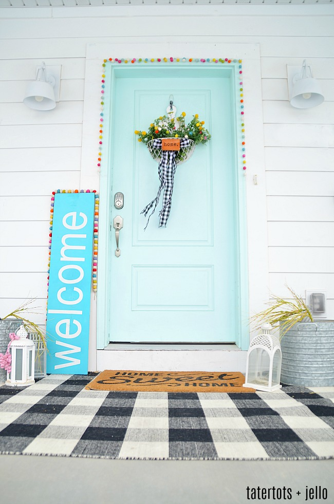 Spring Farmhouse Pom Pom Wreath - turn a wood organizer into a whimsical farmhouse wreath for your door!