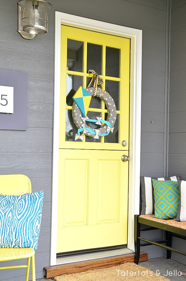 Spring porch with let's fly a kite wreath.