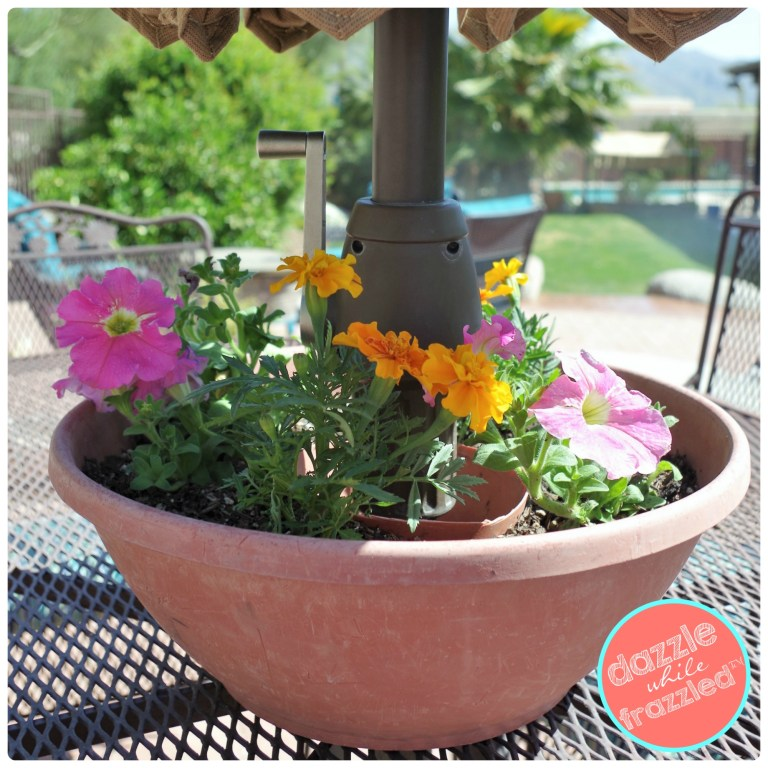 18 DIY Spring Home Ideas! How to make a terra cotta pot that holds flowers around your outdoor patio umbrella.