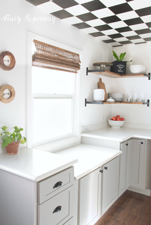 18 DIY Spring Home Ideas!  money on your kitchen remodel by painting your cabinets and adding new door fronts.