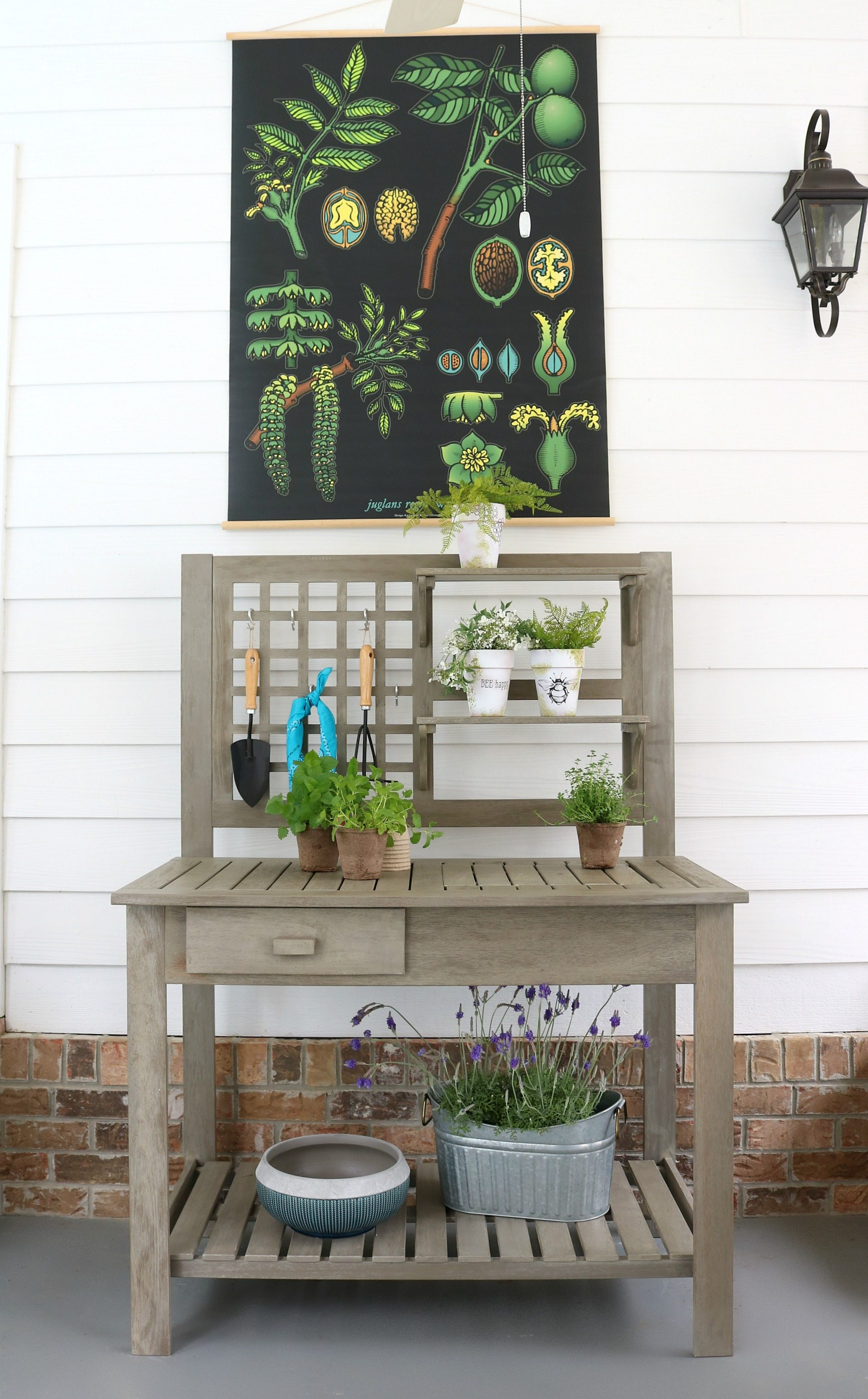18 DIY Spring Home Ideas!  Potting Bench DIY. sSimple wood farmhouse bench with a place t hang tools and shelves for plants.