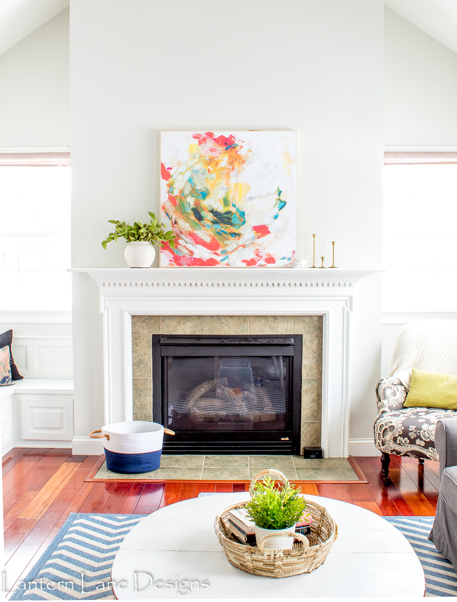 Colorful splashes of paint in a circular pattern on a white canvas.