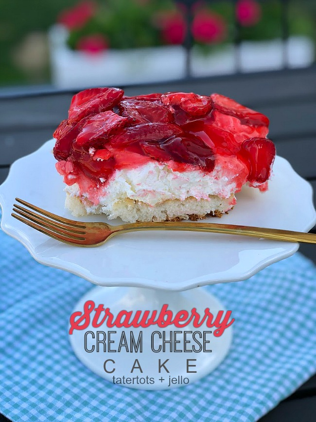 The BEST Fresh Strawberry Cream Cheese Cake Recipe. Moist white cake covered in a fluffy layer of cream cheese and whipped cream with a topping of luscious fresh strawberries in a sweet strawberry glaze. Everyone will fall in love with this delicious, easy cake.