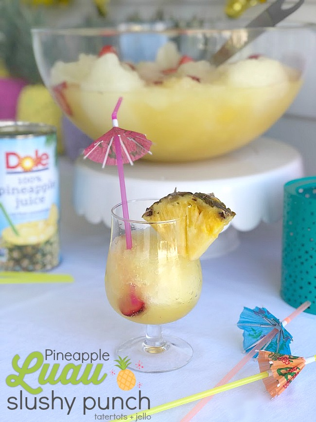 Pineapple Lime Luau Slushy Punch is a party must! Refreshing pineapple and tangy lime combine favors in this fizzy, fruity, slushy punch that makes enough for a crowd!