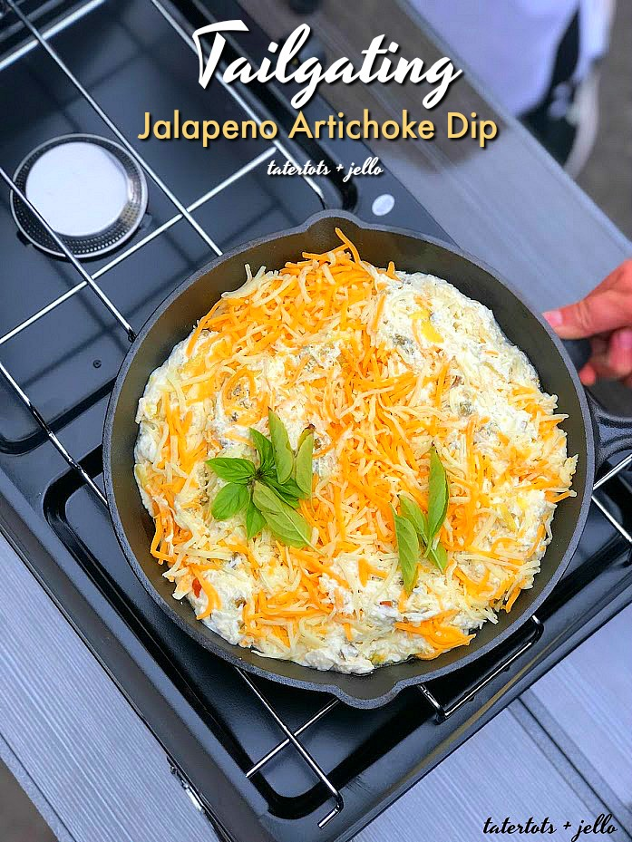Tailgating Jalapeno Artichoke Dip recipe. Make it in the oven OR take it tailgating and cook it on your camp-stove. Creamy and full of flavor with a spicy kick, this dip will be the hit of the party!