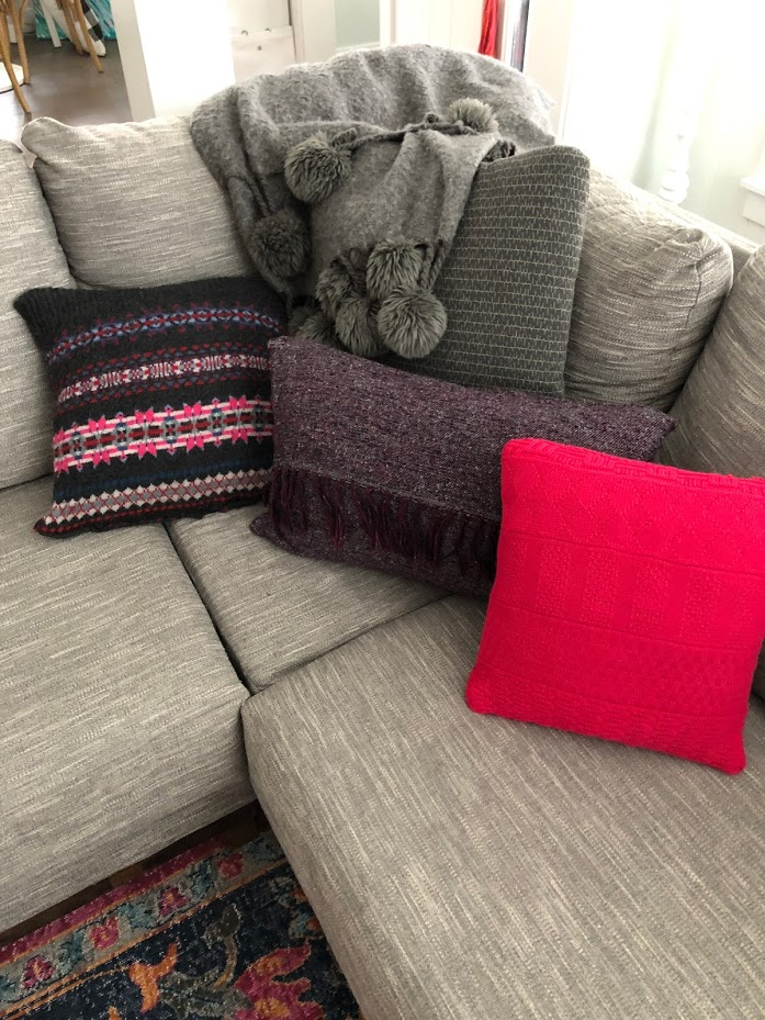 How to make Fall pillows out of thrifted sweaters! Repurpose old sweaters into new and vibrant pillow covers for your home this fall. This easy sewing tutorial shows you how!