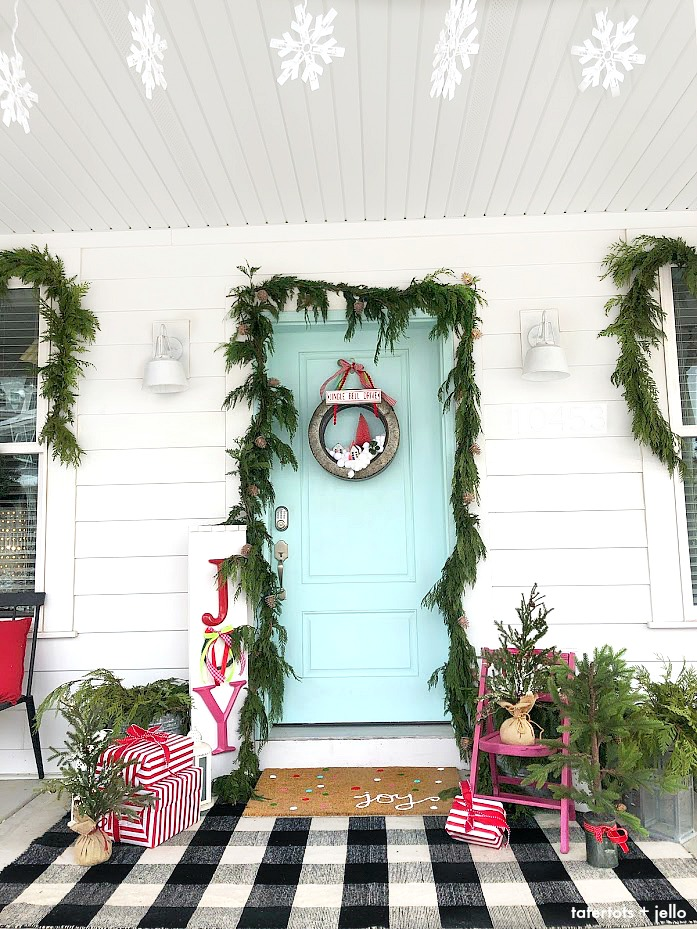 Joy to the World Holiday Porch. Bright colors, a GIANT Joy sign, Snowball Wreath and hand-painted rug create a happy welcome for family and friends with holiday season!