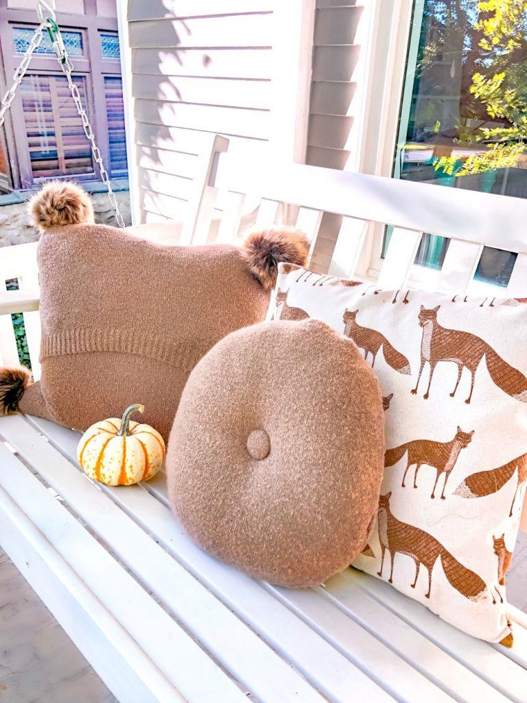 Three-Stitch Sweater Pillows with Fur Pom Poms. Turn old sweaters into adorable pillows. With only three stitches, you can make Sweater Pillows in minutes and add trendy fur pom poms.