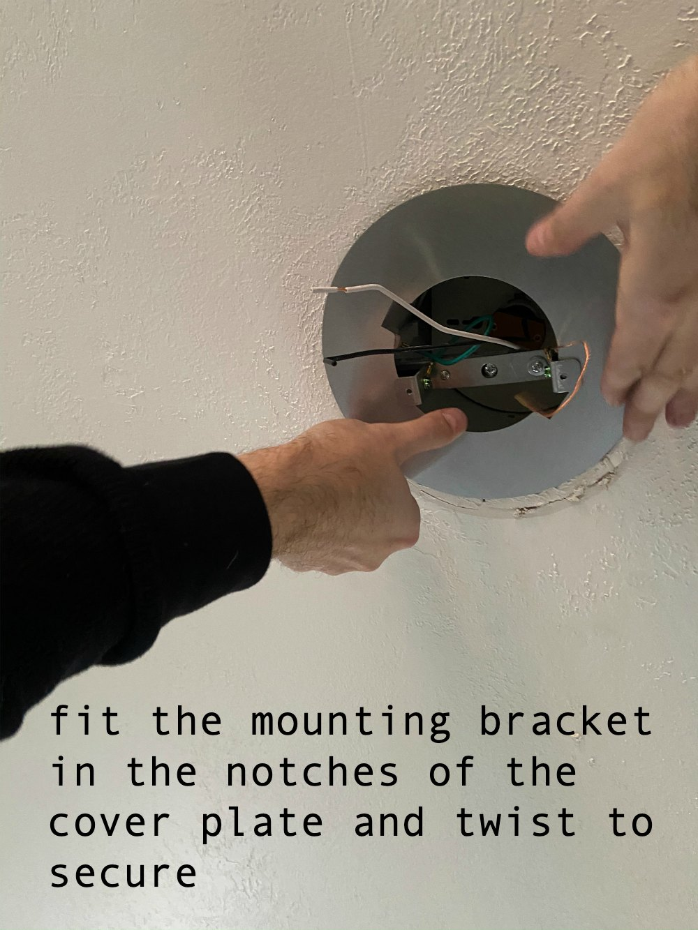 Fit the cover plate over the mounting bracket and twist to secure.