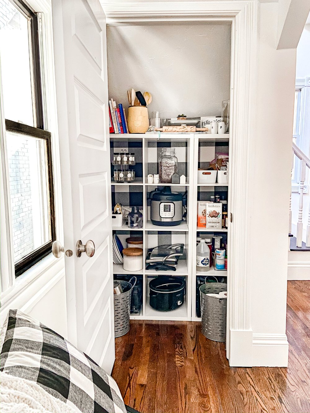 Turn a Closet into a Pantry in one hour! Get organized by turning a coat closet into a pantry in this project that can be put together in one hour!  #organization #kitchenpantry #kitchenorganization #organized