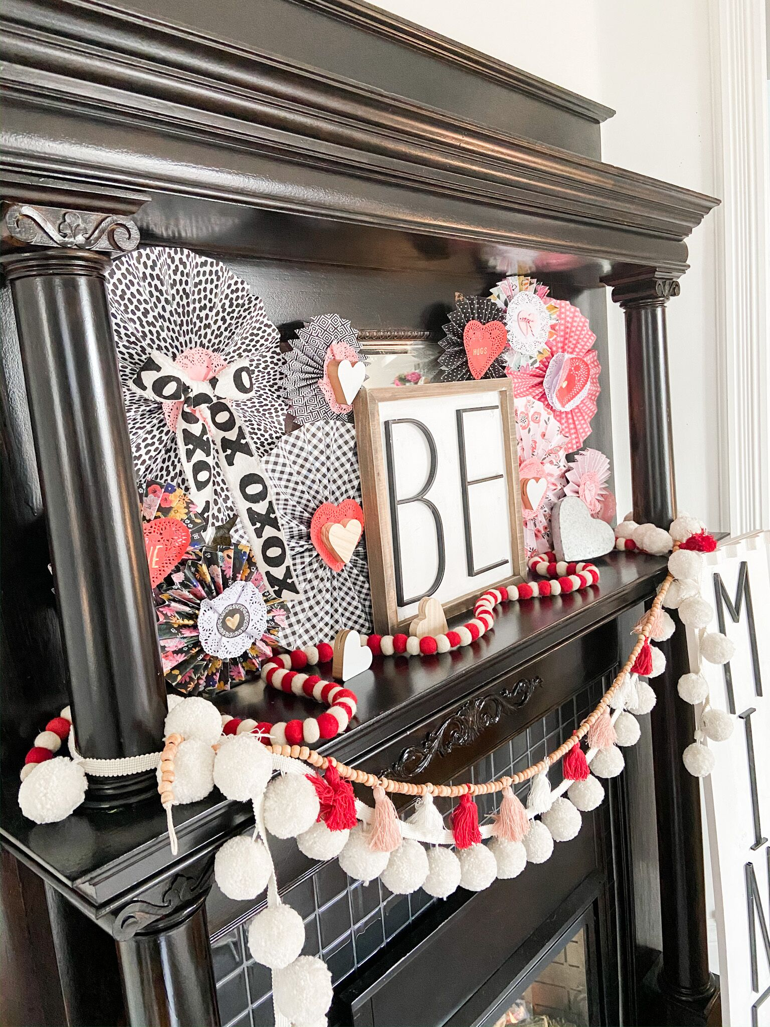 Valentine Be Mine mantel with handmade paper medallions, garlands and DIY wood signs.