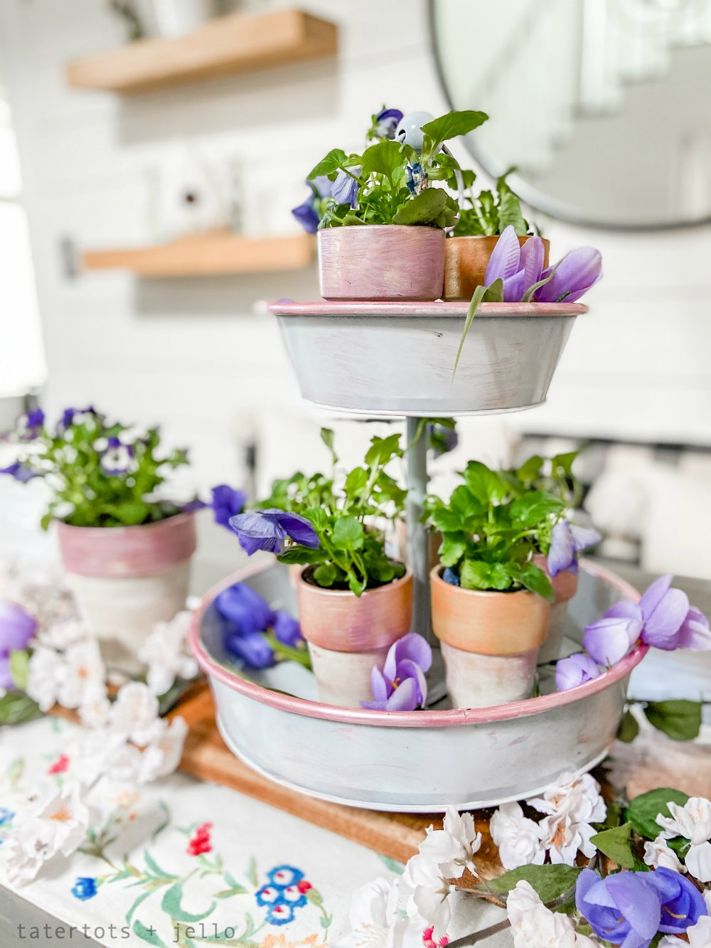 Painted Suede and Metallic Terra Cotta Pots Centerpiece. Create a beautiful Spring centerpiece or pots for your porch with this easy tutorial using suede and metallic paints!