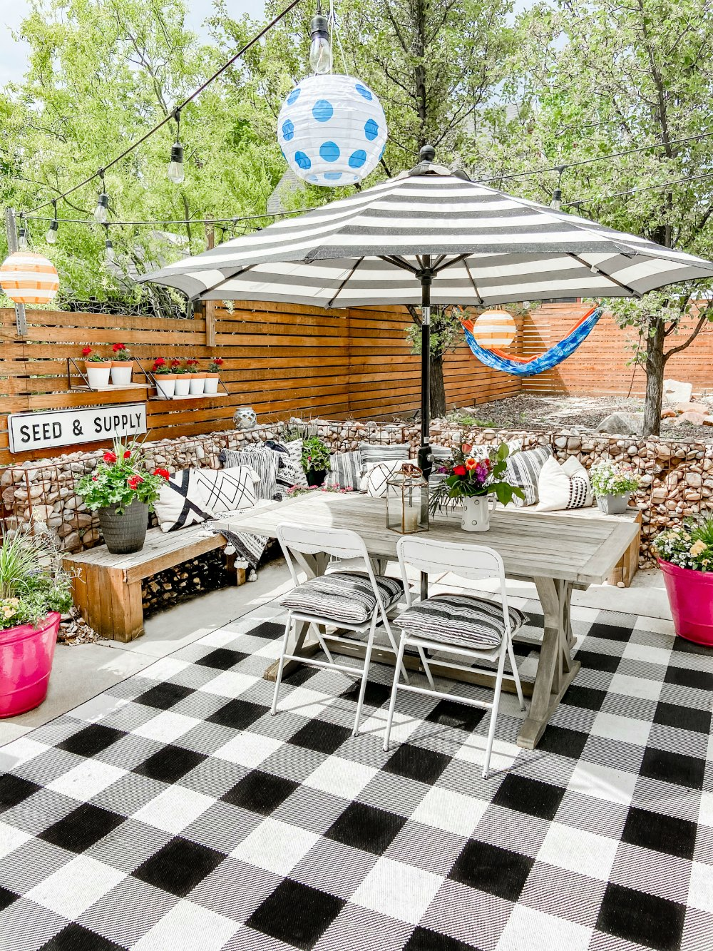 DIY Hanging Patio Garden. Make the most of your patio space by hanging shelves and planting flowers or herbs in painted pots!