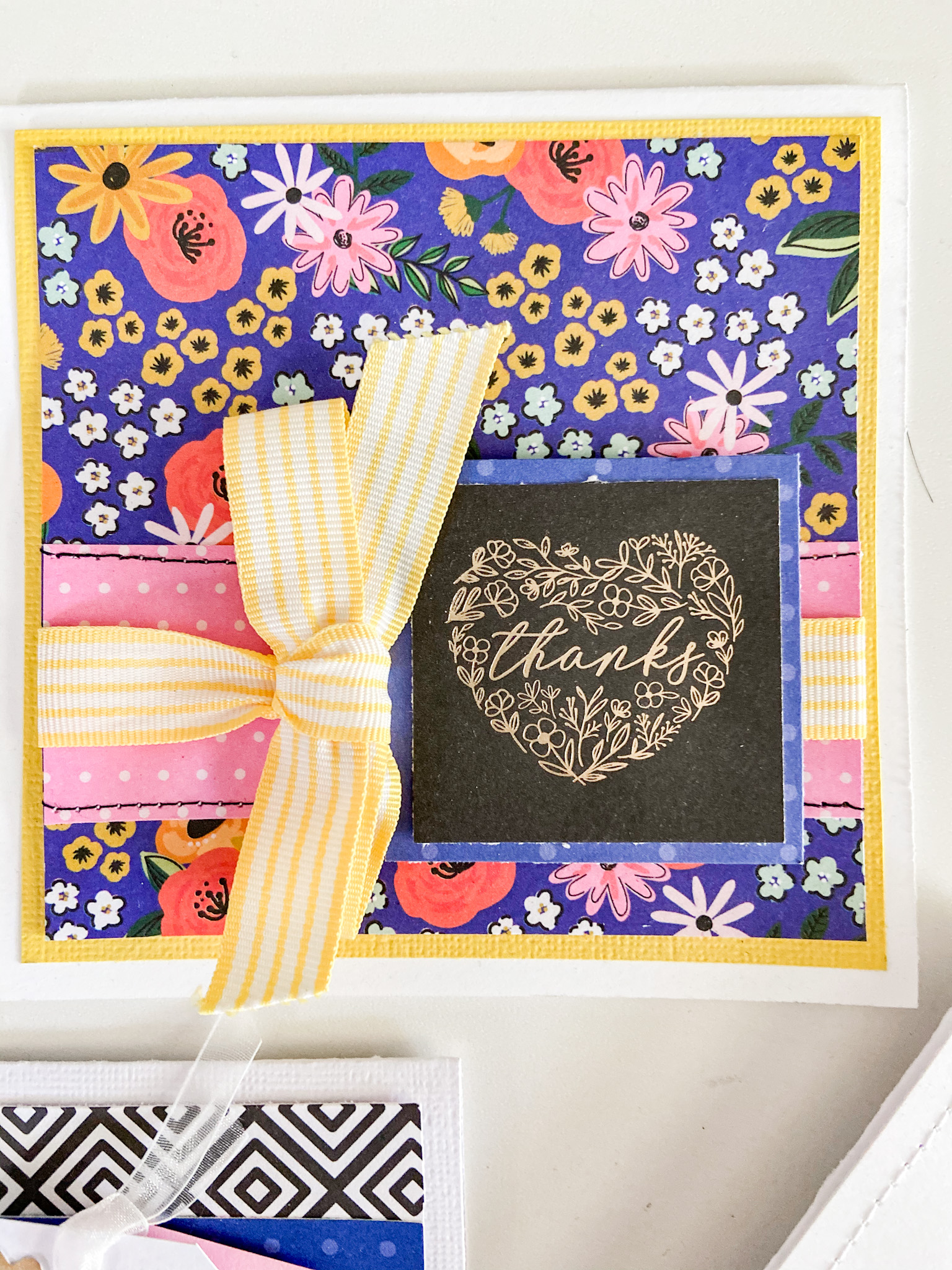 Blue and yellow thank you card with full instructions.