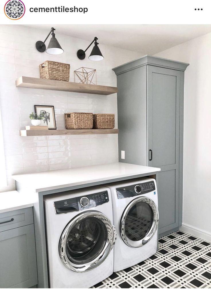 Black and white geometric shaped tile farmhouse laundry room.
