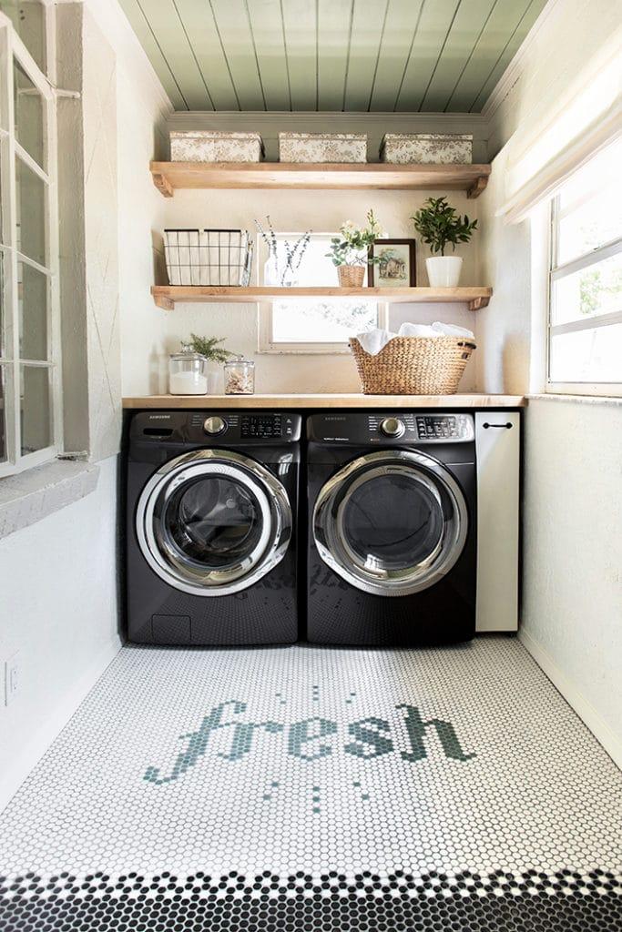 fresh tile spelled out on laundry room floor.
