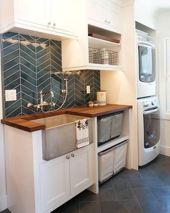 Cement farmhouse sink in a farmhouse laundry room.