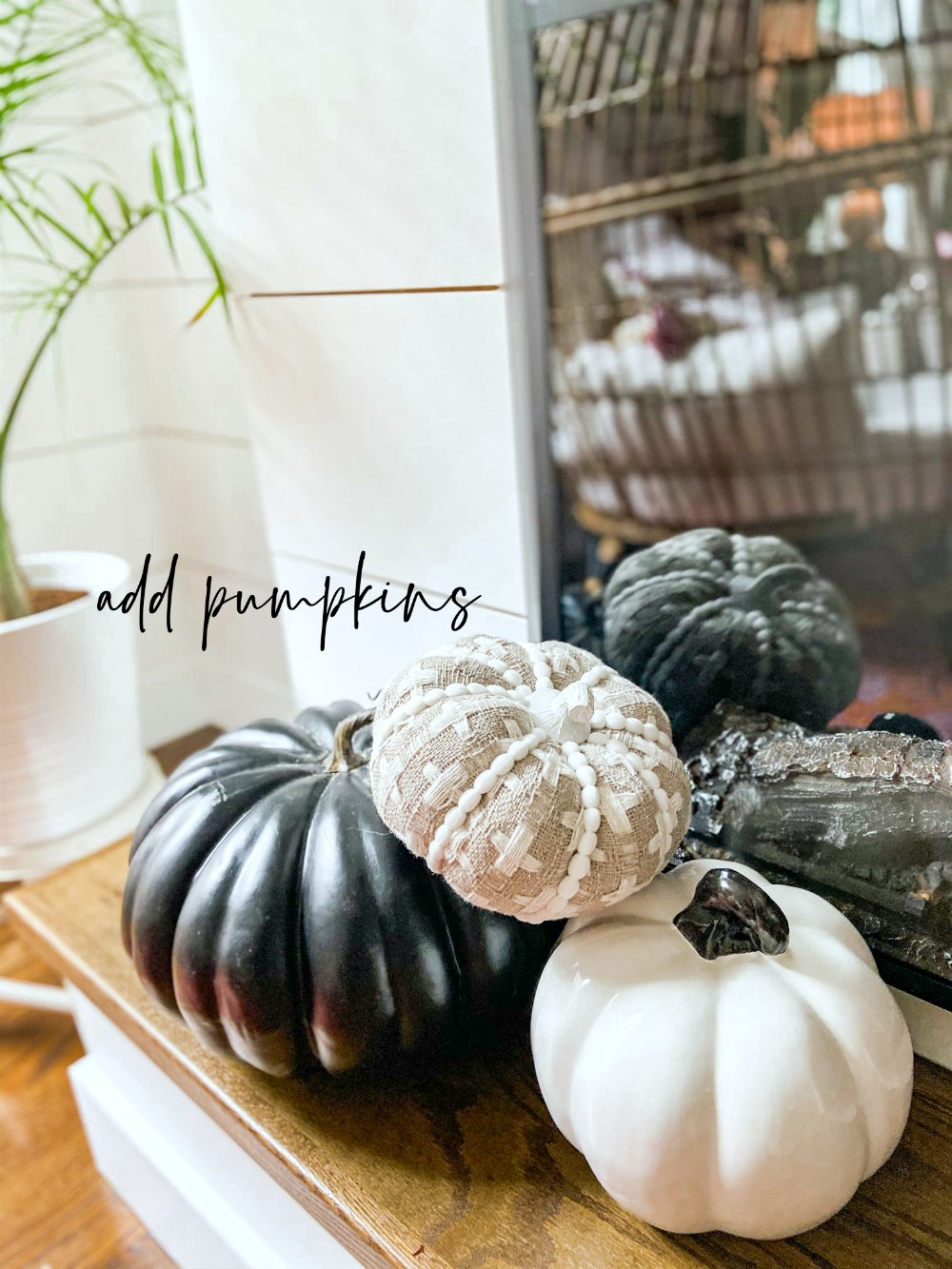 Easy Black and White Fall Mantel! Create a striking black and white mantel with pumpkins, DIY paper medallions and paper banner!