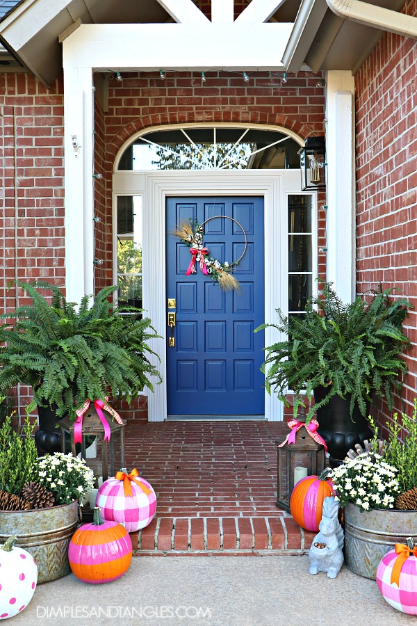 Dimples and Tangles fall porch with plaid DIY pumpkins