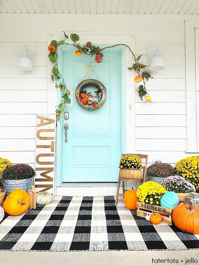 Plaid rug on fall porch