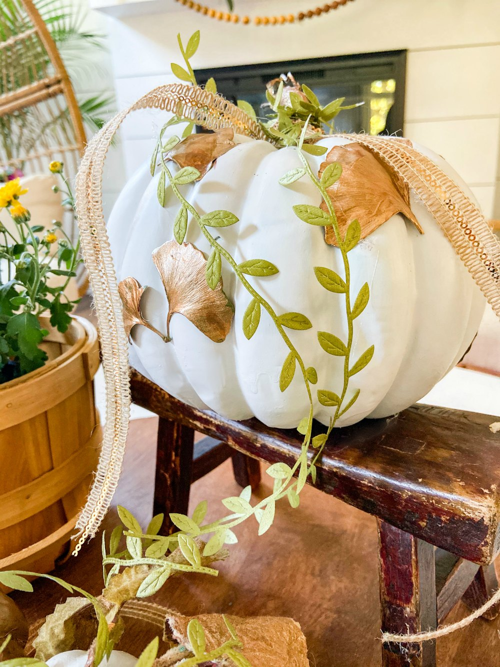 DIY Gilded Leaf Pumpkins. Celebrate fall with a leaf-inspired pumpkin for a fresh take on Autumn.