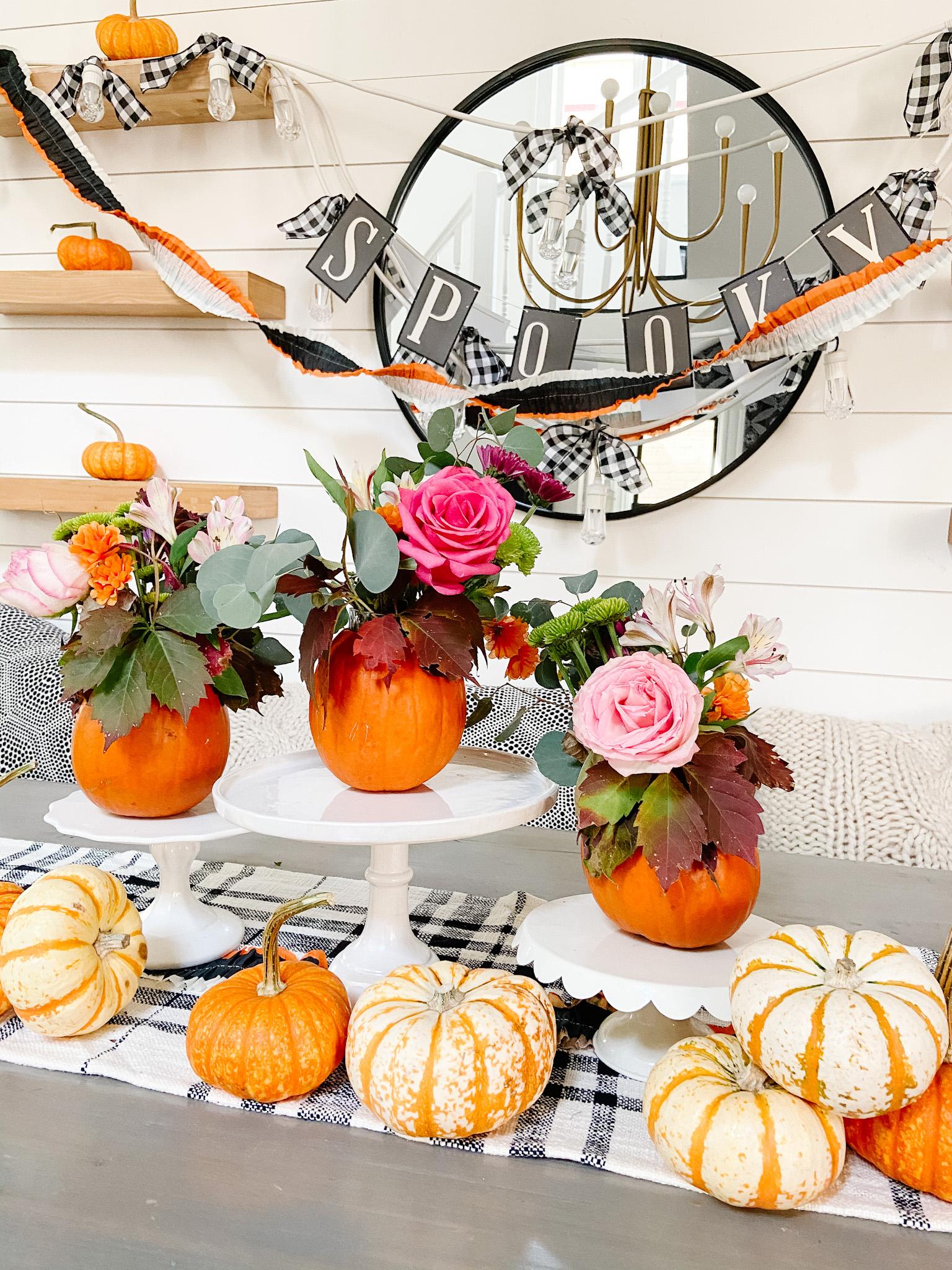 Mini Pumpkin Flower Arrangement Fall Centerpiece. Carve small pumpkins and display cut flowers for an festive fall centerpiece.
