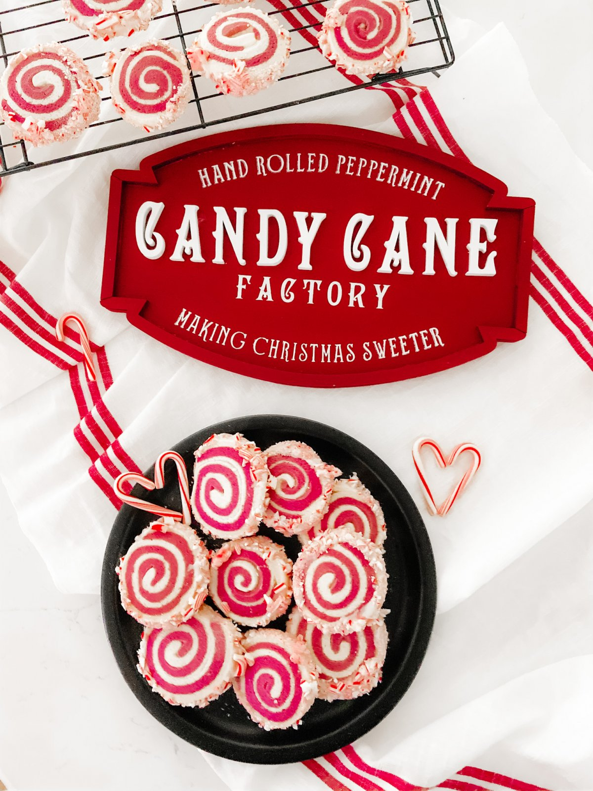 Candy Cane Frosted Swirl Cookies. Take the classic candy cane cookie and give it a modern update by rolling it, frosting it and rolling it in crushed candy canes!