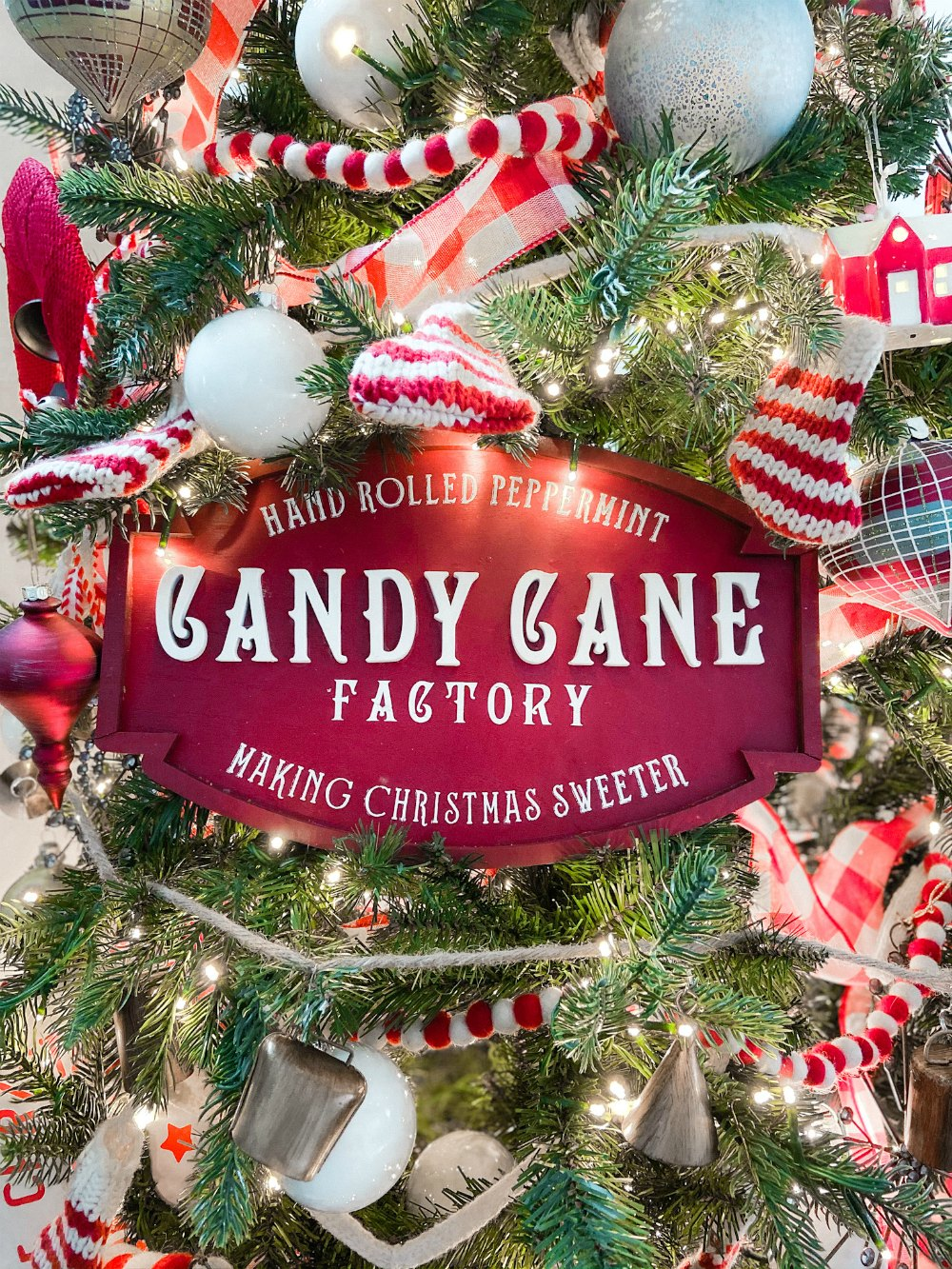 Candy Cane Themed Christmas Tree. Celebrate Christmas with a festive red and white tree filled with candy cane-themed projects, bells and felted garlands.