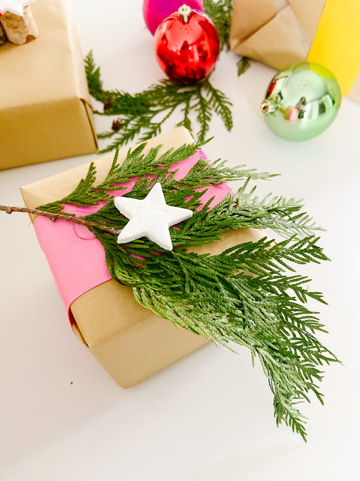 Baking Soda Clay Gift Wrap Embellishment DIY. Using only two pantry ingredients and foraged items from your yard, you can create gorgeous gifts that will look stunning under your tree.