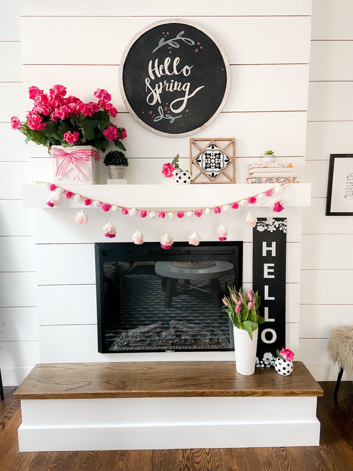 Colorful Spring Mantel with DIY Chalkboard Sign. Add spring color to your home with bright flowers, pretty accents and a DIY chalkboard!