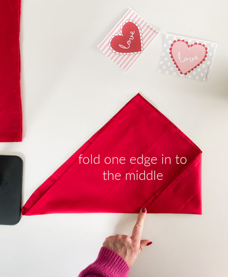 Valentine's Day Table Envelope Napkins. Fold napkins in an envelope shape and add a special hand-written note with free printable cards!