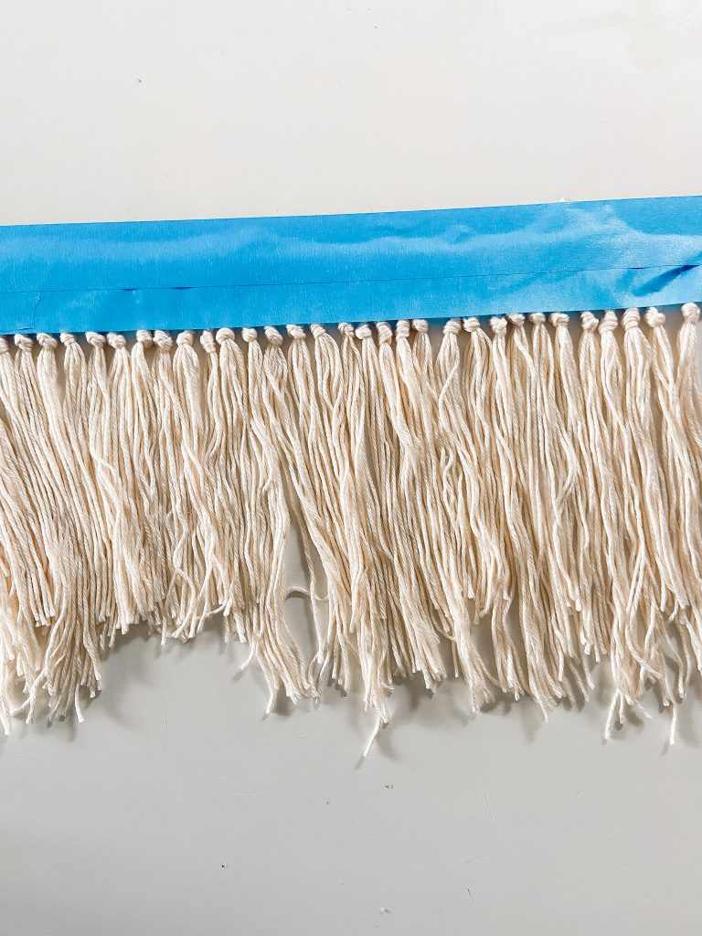 Envelope Pillow Cover with Macrame Fringe Trim. Add a little boho detail to your next pillow with this easy fringe idea and easy pillow!