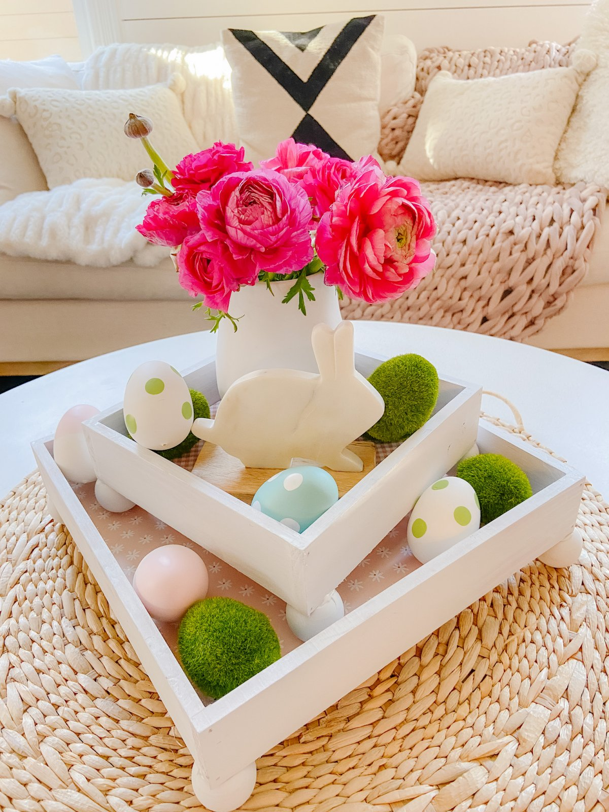 DIY Spring Footed Stacking Tray Centerpiece. Add ball feet to simple wood boxes, add scrapbook paper and layer with fresh flowers and spring items for a pretty centerpiece!