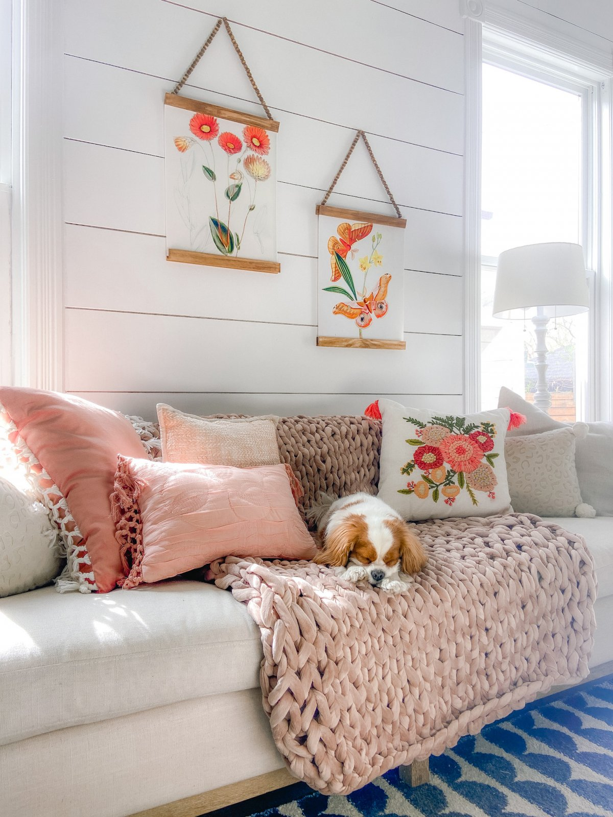 Spring Botanical Prints with DIY Beaded Hangers. Bright flowers match a spring pillow on a pink blanket.