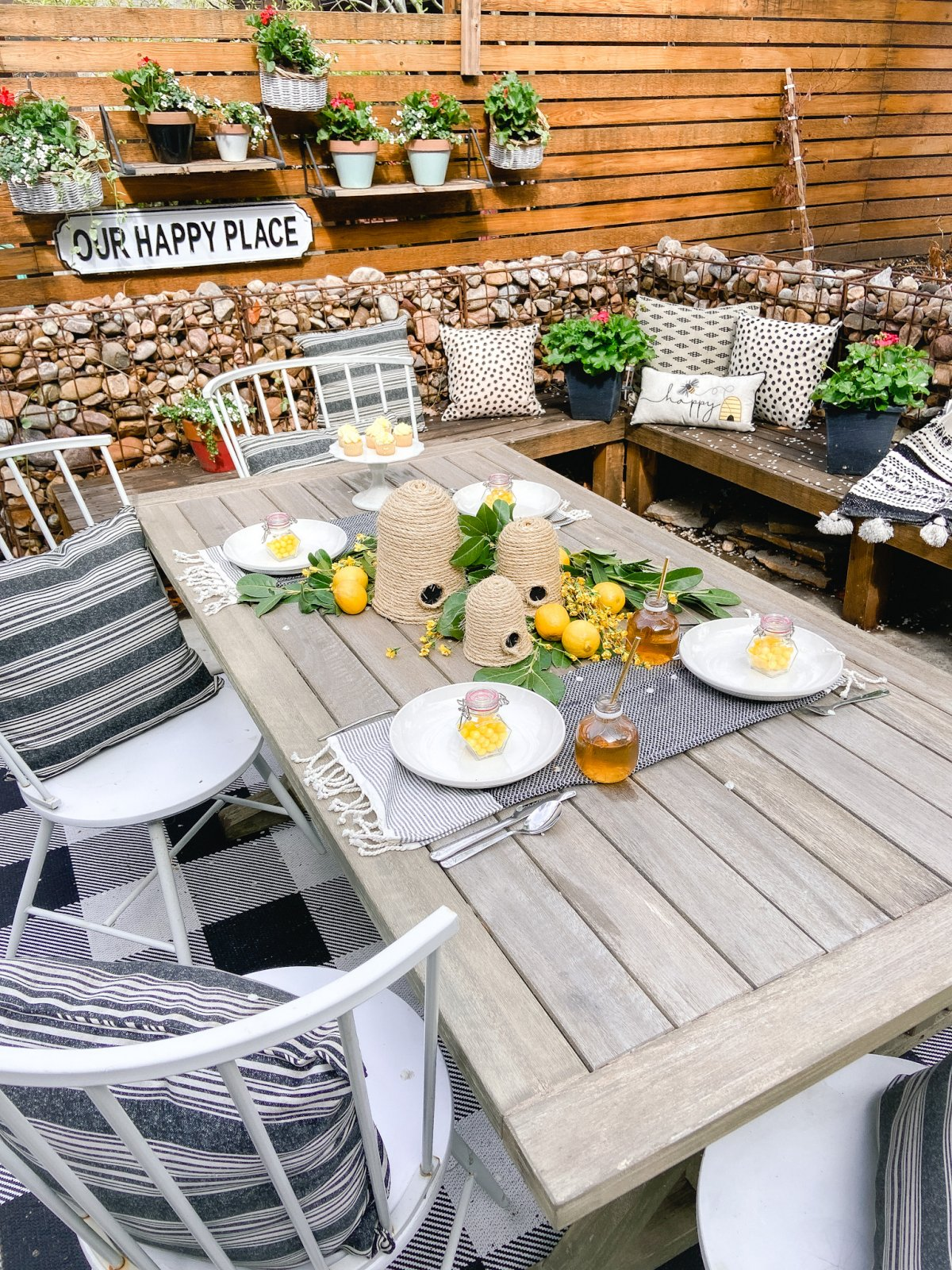 DIY Beehives and Beehive Backyard Inspo! Create cute and inexpensive beehives, add beehive pillows and create a hanging basket garden for a beautiful summer patio!